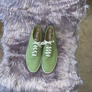 Men green Keds sneakers.